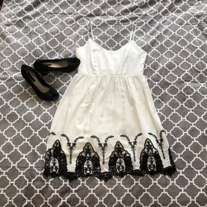 White dress with black stitch work